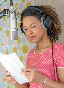 black british voiceover artist working in her studio