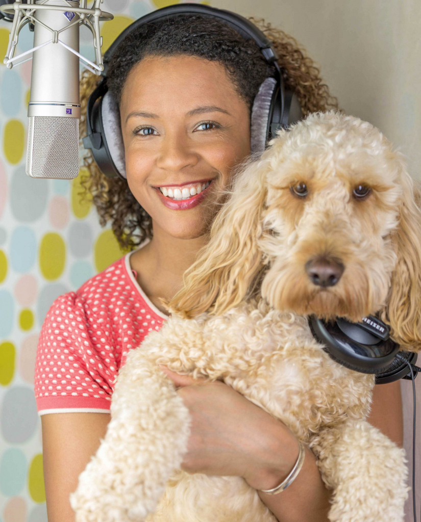 Diverse British Female Voiceover Talent in Voice Booth with Neumann U87 microphone and dog
